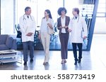 doctors walking with colleagues ... | Shutterstock . vector #558773419