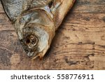 Small photo of Salty stockfish on wooden table. Common bream (Abramis brama)