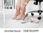 barefoot woman in office at work   Shutterstock . vector #558781099