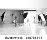Small photo of Empty photo studio with lighting equipment
