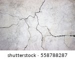 cracked concrete wall covered with gray cement surface as background