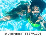 friends diving underwater in... | Shutterstock . vector #558791305