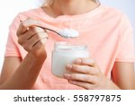 close up of woman with spoonful ... | Shutterstock . vector #558797875