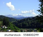 Small photo of Through the window of my room I perceive the Swiss mountain, green, fresh and sunny