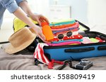 female hands packing traveler... | Shutterstock . vector #558809419