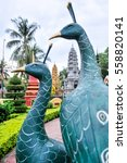 Small photo of Detail of peackocks statues in the Preah Prohm Rath temple, Siem Reap. Cambodia