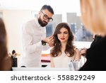 hairdressers styling makes the... | Shutterstock . vector #558829249