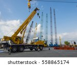 Small photo of many Truck and Crane in yard site consist of lifting, pulley, sling, derrick are ready for construction