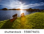 Boats Dock At Edge Of Lake In...