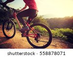 young woman riding mountain... | Shutterstock . vector #558878071
