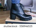 women boots on wooden background | Shutterstock . vector #558946525