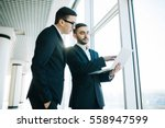 two young businessmen... | Shutterstock . vector #558947599