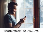 young bearded man standing by...   Shutterstock . vector #558963295