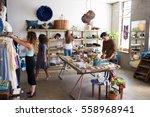 customers and staff in a busy... | Shutterstock . vector #558968941
