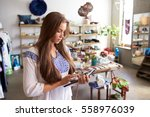 teenage boutique assistant ... | Shutterstock . vector #558976039
