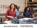 team packing orders for... | Shutterstock . vector #558988381