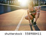 athletic woman prepares to run... | Shutterstock . vector #558988411