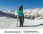 skier on the mountain top with... | Shutterstock . vector #558994951
