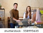 man and young woman working in... | Shutterstock . vector #558995635