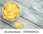 potato chips in bowl on a... | Shutterstock . vector #559000414