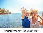 cute little boy waving at the... | Shutterstock . vector #559004401