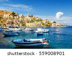 fishing boats at harbour of... | Shutterstock . vector #559008901