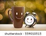 brown mug  alarm clock of... | Shutterstock . vector #559010515