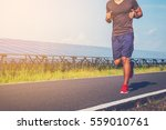 handsome man running on road... | Shutterstock . vector #559010761