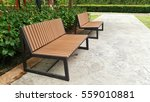 Two Wooden Benches On Cement...