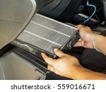 Small photo of Technician take-off dirty air filter for change