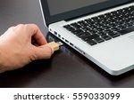 hand inserting usb  flash drive ... | Shutterstock . vector #559033099