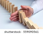 Small photo of Stop Domino Effect - Hand Prevents Failure