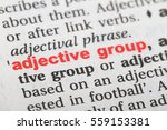 Small photo of Closeup of English dictionary page with word adjective group.
