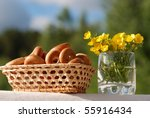 Biscuit cookies with a poppy in a wattled basket against the sky - stock photo
