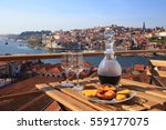 Small photo of Table with view a wonderful view over the river in Porto, Portugal.