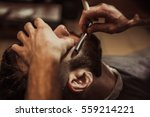 men barber shaves his beard. | Shutterstock . vector #559214221