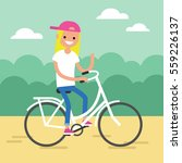 young blond girl riding a bike... | Shutterstock .eps vector #559226137