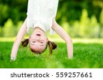 happy young child playing head... | Shutterstock . vector #559257661