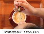 top view latte art coffee on... | Shutterstock . vector #559281571