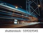 car light trails and urban... | Shutterstock . vector #559319545