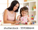 happy family. mother and kid... | Shutterstock . vector #559388644