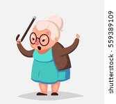 angry old woman brandishing her ... | Shutterstock . vector #559389109