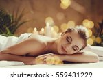massage. beautiful girl in spa... | Shutterstock . vector #559431229
