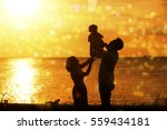 silhouette of happy family... | Shutterstock . vector #559434181