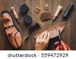 cobbler tools in workshop dark... | Shutterstock . vector #559472929