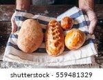 Baker Holding Fresh Hot Bread...