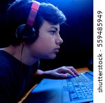 teenager gaming on his laptop | Shutterstock . vector #559485949
