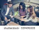 three  colleagues having a... | Shutterstock . vector #559490335