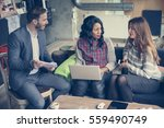 three  colleagues having a... | Shutterstock . vector #559490749