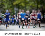 marathon runners in the city  | Shutterstock . vector #559491115